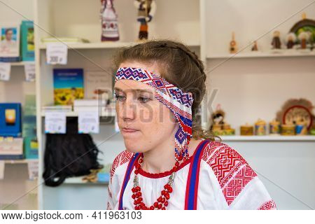 Moscow, Russia, June 02, 2019: A Young Woman In A Russian National Costume With A Beaded Headband An