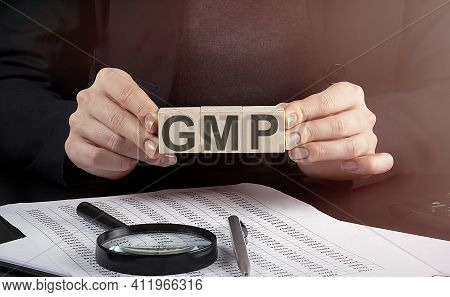 Businesswoman Holding Wooden Block With Text Gmp Abbreviation Of Good Manufacturing Practice , Busin