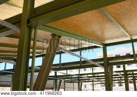 Metal Framework Of Hangar. Metal Supporting Structures. Beams And Girders Of Truss Ceiling.