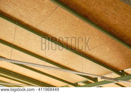 Metal Framework Of Hangar. Beams, Girders And Ceiling Sheets Of Industrial Building.