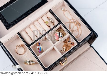 Yellow Gold Jewelry Collection In Jewelry Box On Light Marble Background. Diamond Pendant Necklaces,