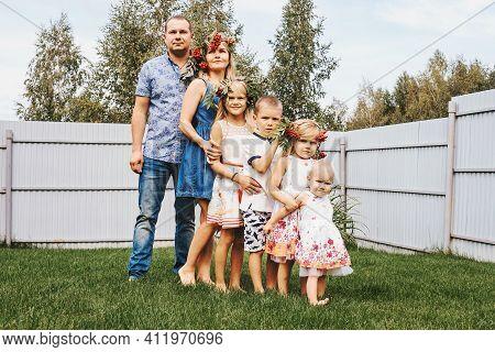 Happy Large Family With Children In Garden, Summer Portrait.