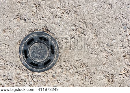 Round Manhole On Concrete Drain System Cover. Urban Sewer Background. Metal Drain Cover Texture. Min
