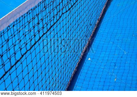 Blue Tennis Court With Black Net. Empty Sport Field Photo. Hard Court Cover For Lawn Tennis. Summer