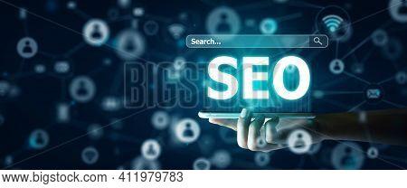 Search Engine Optimisation(seo) On Smart Phone Concept. Smart Phone Of Businessman Holding Seo Holog