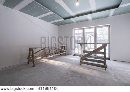 Empty White Room Without Repair And Furniture With Scaffolding
