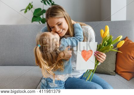 International Womens And Mothers Day. Little Cute Daughter With Bouquet Of Yellow Flowers And Postca