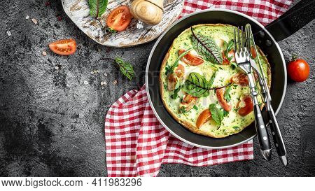 Healthy Frittata In Pan With Eggs, Cheese And Spinach Salad. Italian Omelette Keto, Ketogenic Lunch.