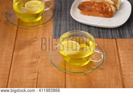 Lemon Tea In A Glass Cup On The Wooden Table.