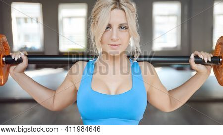 Strong Sexy Athletic Young Woman Working Out In Gym