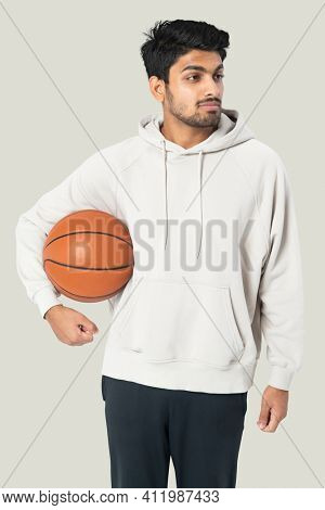 Indian basketball player in a white hoodie men's apparel photoshoot