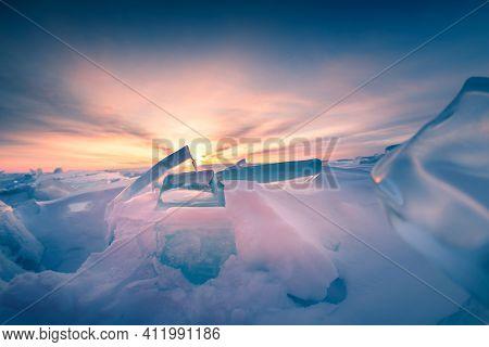 Ice On Winter Baikal Lake At Sunrise. Beautiful Winter Landscape. Baikal, Siberia, Russia. Selective