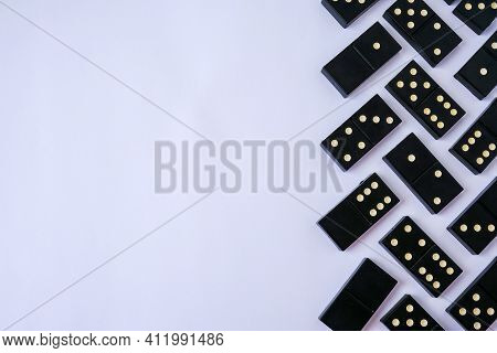 Black Old, Vintage Dominoes On White Background. The Concept Of The Game Dominoes. Selective Focus.