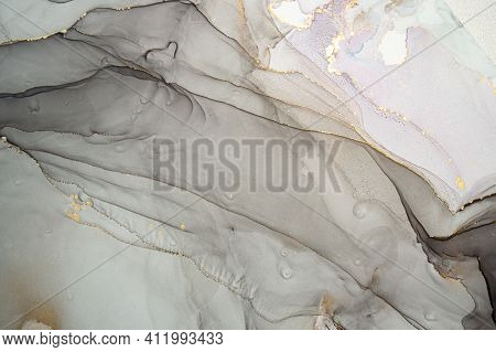 Gold Abstract Background Liquid. Alcohol Inks Splash. Elegant Wave Mix. Oil Marble Pattern. Abstract