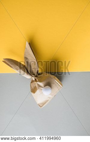 Easter Bunny Paper Gift Egg Wrapping Diy Idea On Colorful Background. Minimal Easter Concept, Flat L