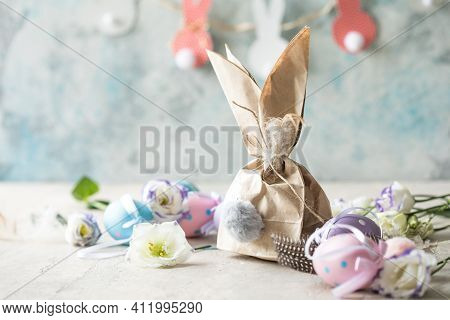 Pom Pom Easter Bunny Craft. Easter Bunny Decoration Paper Gift. Diy Holiday Garland Of Colorful Rabb