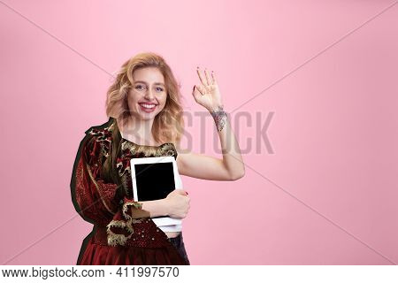 Woman With Tablet Blank Screen. Magazine Style Collage With Model Outfit Mixed Of Different Eras. Co