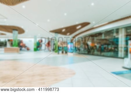 Shopping Supermarket Blurred Background. Interior Of Retail Centre Store In Soft Focus. People Shopp