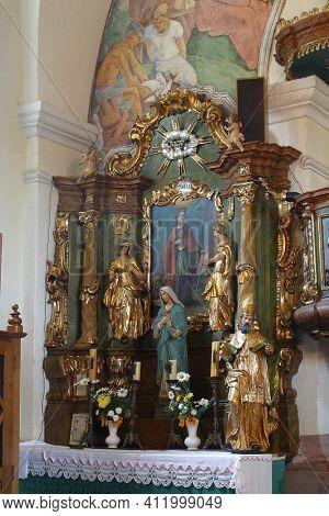 SVETI PETAR MREZNICKI, CROATIA - JULY 14, 2013: Altar of St. Barbara at St. Peter's Parish Church in Sveti Petar Mreznicki, Croatia