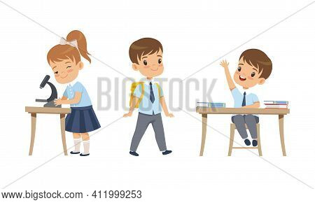 Elementary School Students Studying At School, Adorable Boys And Girl In School Uniform During Lesso
