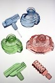 Antique scent bottles in red green and blue. Decorative glass poster