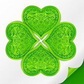 Green plastic ornate lucky clover on paper with curved corner poster