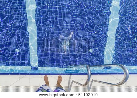 Man Standing At the poolside