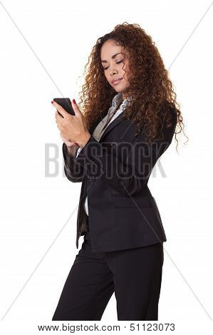 Businessl Woman Looks At Her Cell Phone.