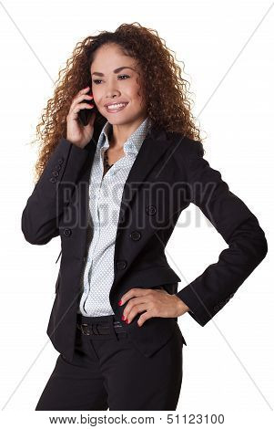 Smiling Woman Talks On Her Cell Phone.