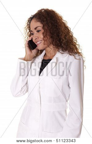 Female Physician Talks On Her Cell Phone.