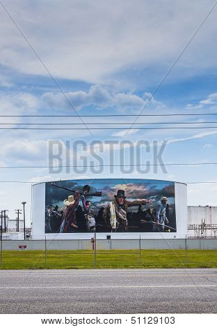 Oil Tanks Are Painted With Historic Texas History Scenes