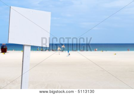 Empty White Sign At The Beach