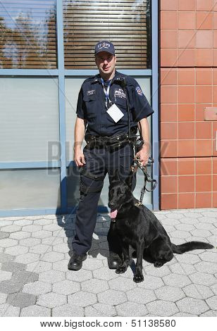 NYPD transit bureau K-9 police officer and German Shepherd Taylor providing security at US Open 2013