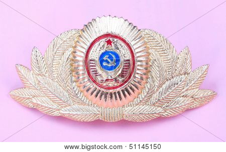 Gold Cockade On Pink Background