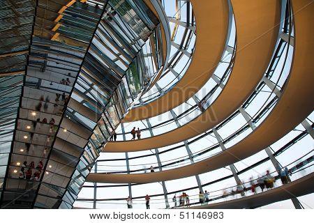 BERLIN, GERMANY - JULY 21, 2013:Tourists inside the glass dome of the Reichstag in Berlin, Germany; July 21, 2013