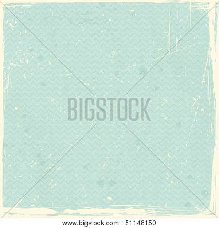 Pale green, blue grunge background, stained and scratched with zig zag pattern.