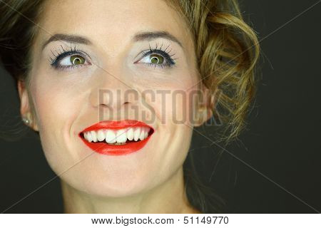 Portrait of a laughing beautiful woman, close-up