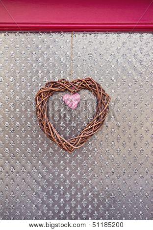 Handmade Decorative Hearts Over Figured Glass Background