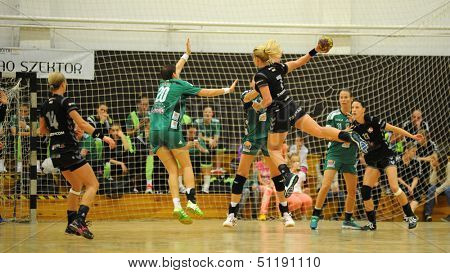 SIOFOK, HUNGARY - SEPTEMBER 14: Unidentified players in action at a Hungarian Championship handball match Siofok KC (black) vs. Gyori Audi ETO KC (green), September 14, 2013 in Siofok, Hungary.
