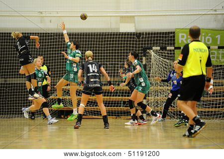 SIOFOK, HUNGARY - SEPTEMBER 14: Unidentified players in action at a Hungarian National Championship handball match Siofok KC (black) vs. Gyor (green), September 14, 2013 in Siofok, Hungary.