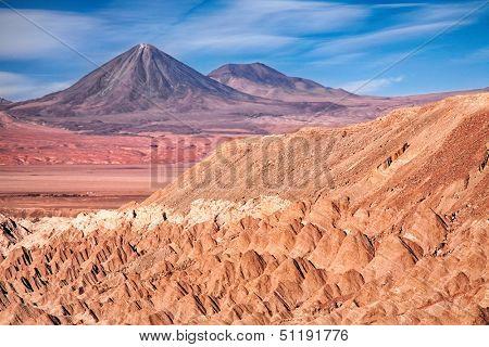view from Valle de la Muerte (Death Valley) on the volcanoes Licancabur and Juriques, desert Atacama, Chile