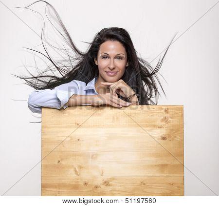 Beautiful woman behind advertising board