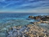 Rocky but beautiful coast of the clean Adriatic sea poster