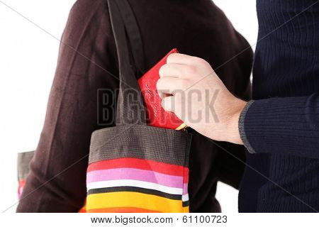 Pickpocket are stealing wallet from bag, close up, isolated on white