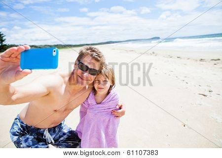 Father Taking Selfie Photograph With Daughter At Beach