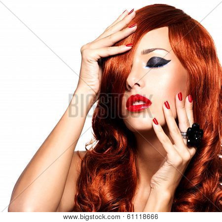 Sensual Woman With Long Red Hairs And Red Nails