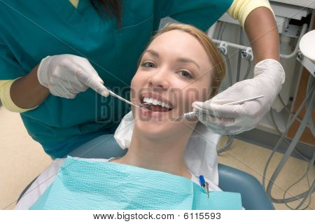 Caucasian Woman And African-american Dentist