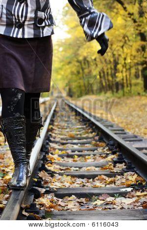 Women Walking On Rails