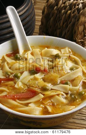Thukpa / Gya -Thuk is a very popular Sikkimese dish made from long egg noodles in broth with a choice of vegetables. poster