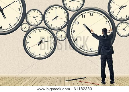 Asian business repair the clock, concept of time management, rebuild, busy etc.